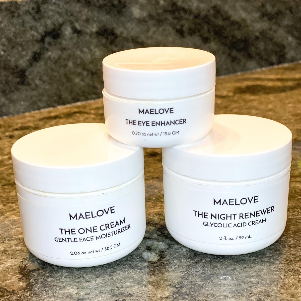 maelove skincare lotions on green granite countertop