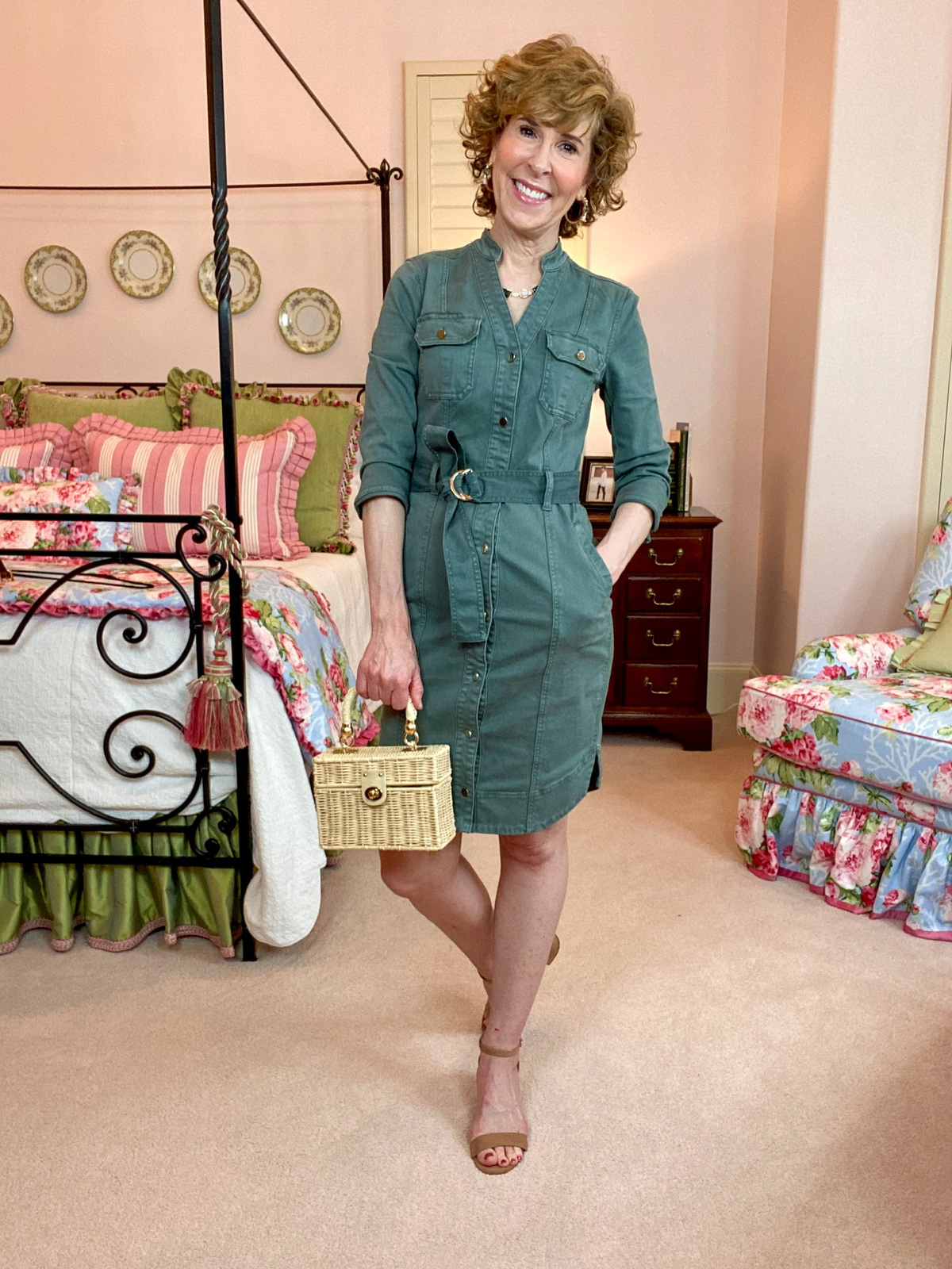 woman wearing WHBM green shirtdress standing in bedroom