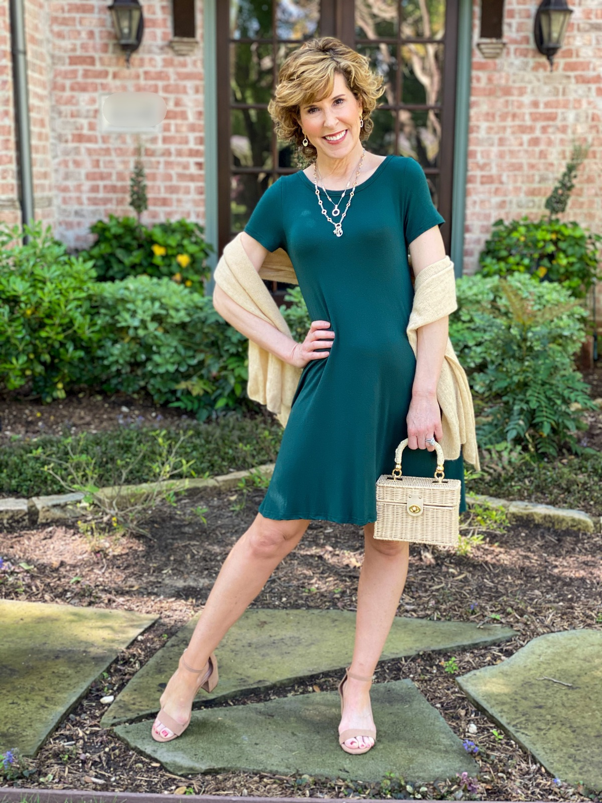 woman in green dress with gold wrap