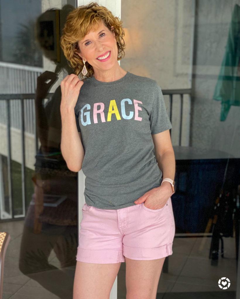 woman standing on patio wearing GRACE tee