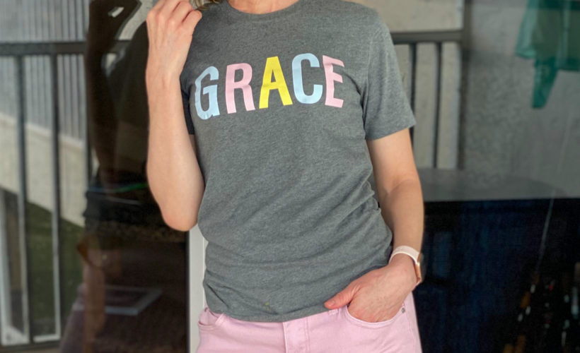 woman standing on patio wearing GRACE tee