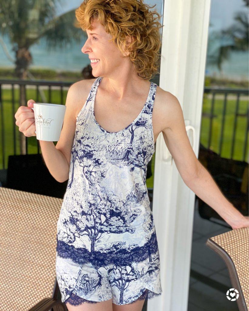 woman in pajamas standing on patio