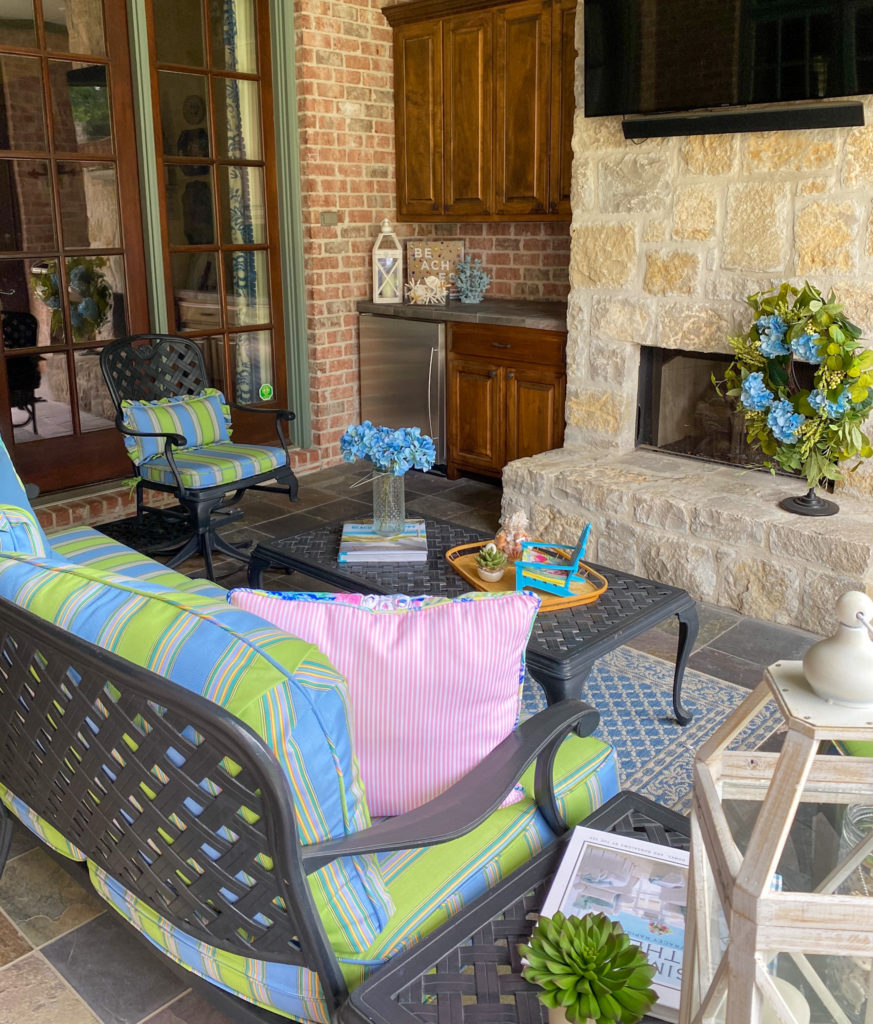 back view of updated back patio furniture and decor