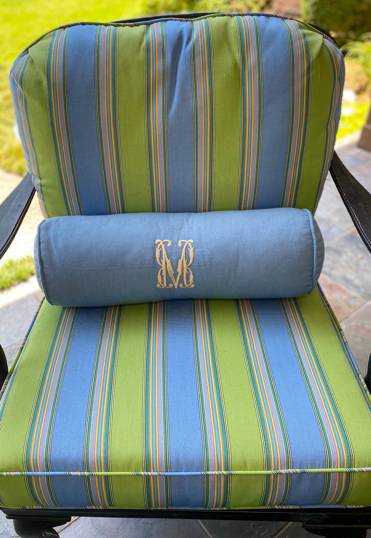 frontgate blue bolster pillow on striped patio cushions