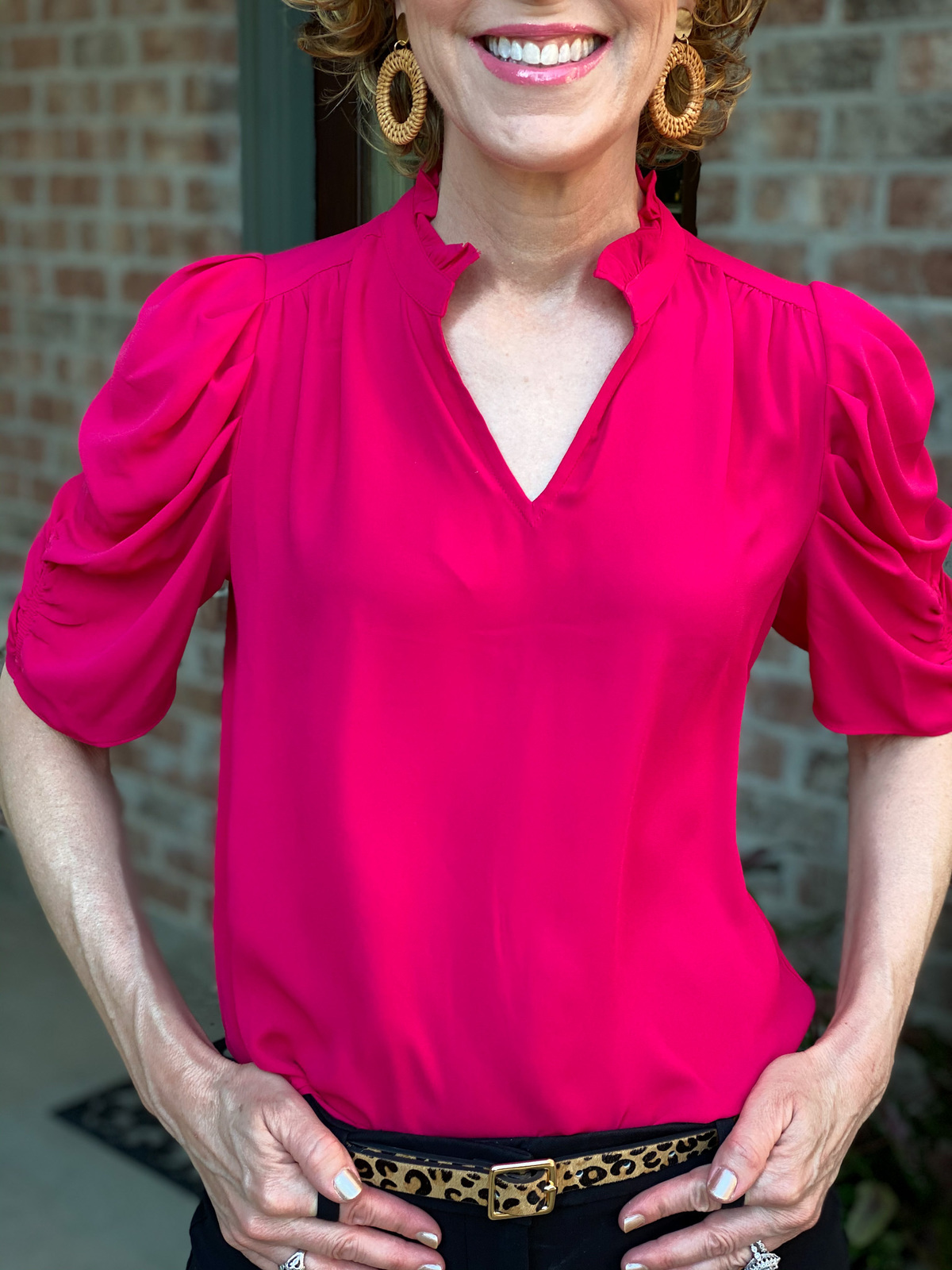 close up of woman wearing lark & ro ruffle neck georgette top