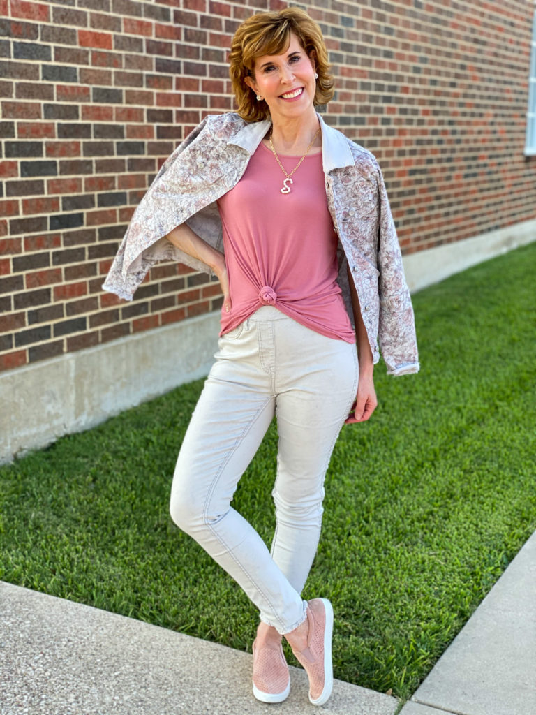 woman over 50 wearing diane gilman for hsn reversible high waisted jeans and matching jacket