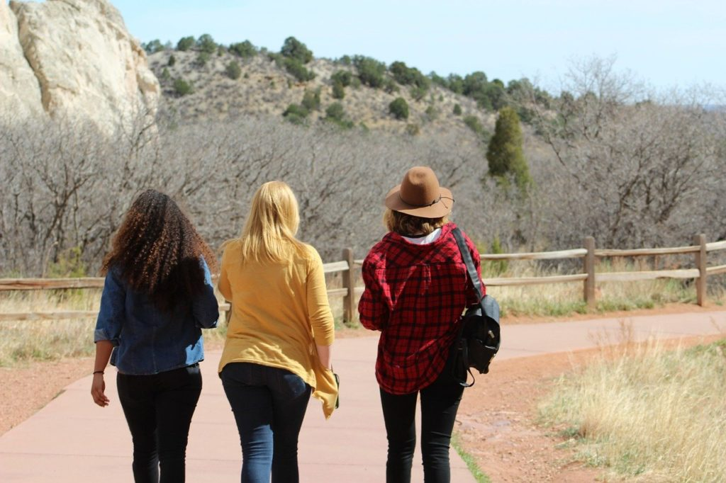 three women walking together