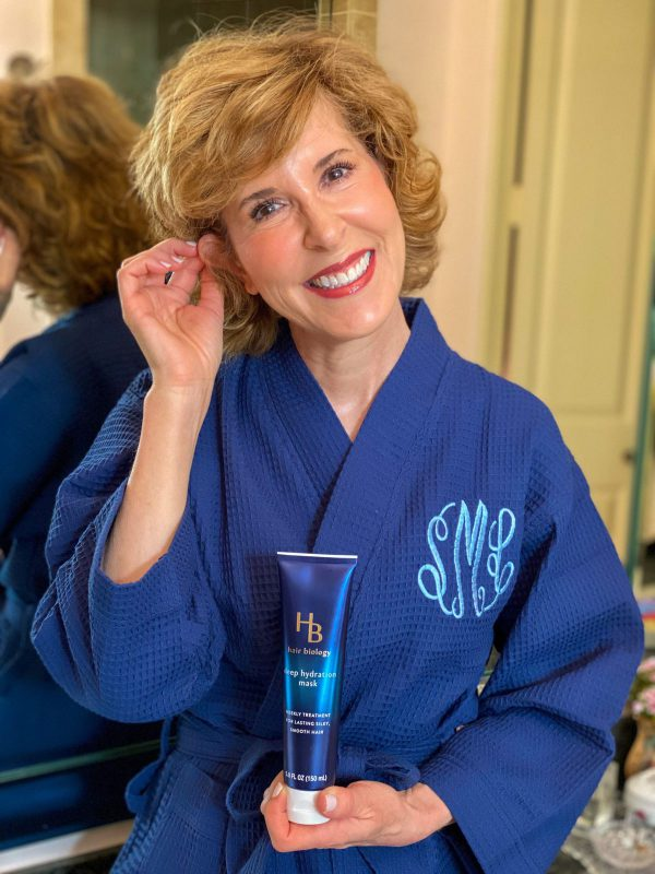 woman holding hair biology deep hydration hair mask