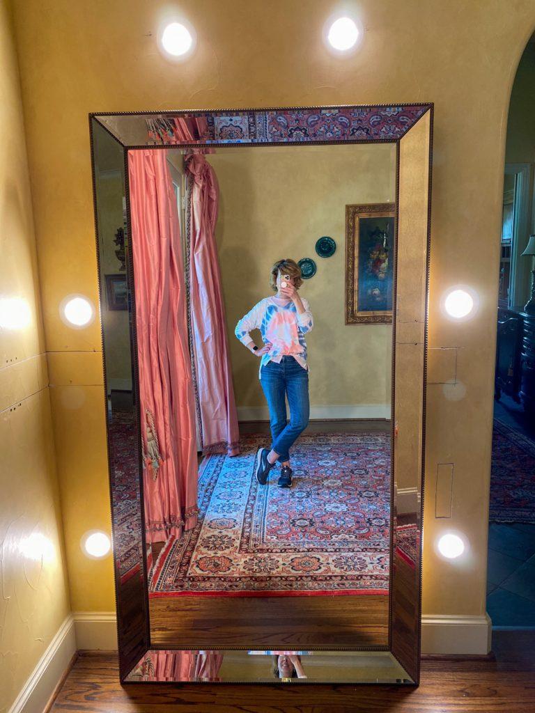 mirror selfie of woman wearing tie-dye