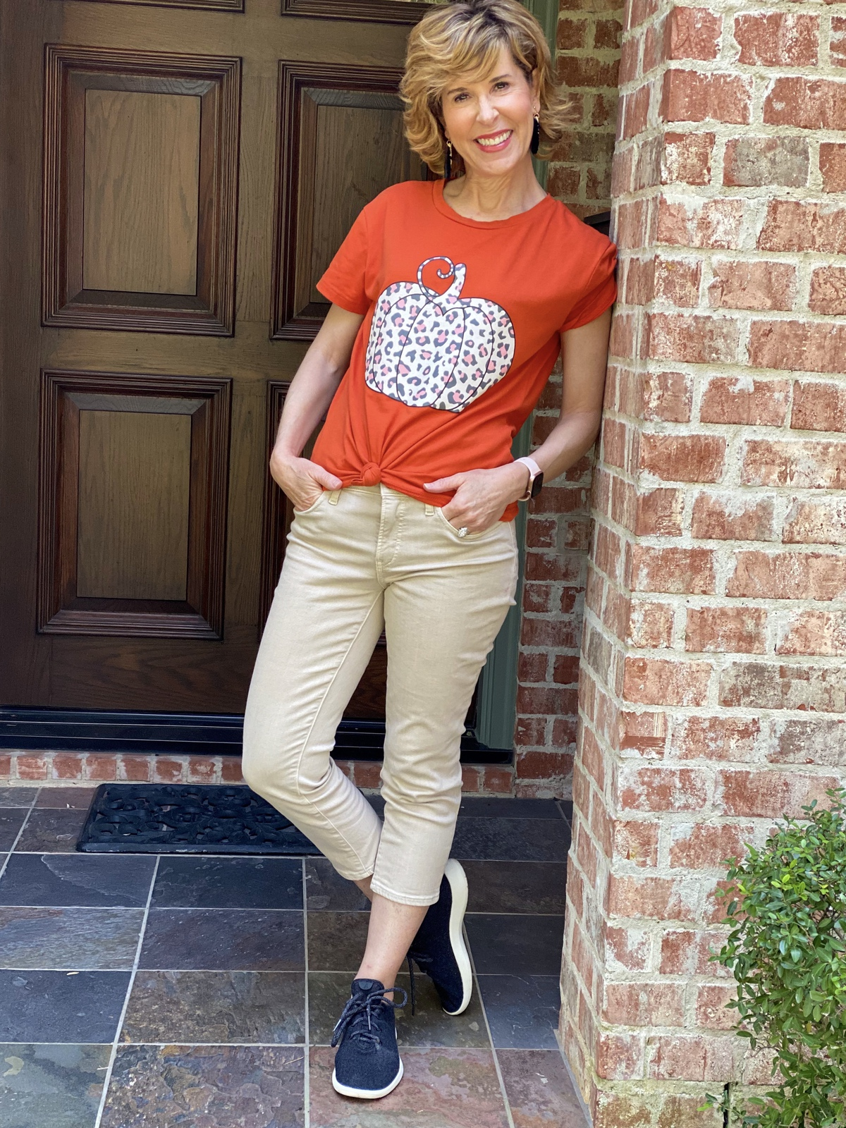 woman wearing amazon fashion animal print pumpkin graphic tee and chico