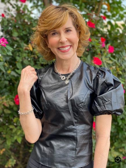 woman wearing faux leather puff sleeve short sleeve top