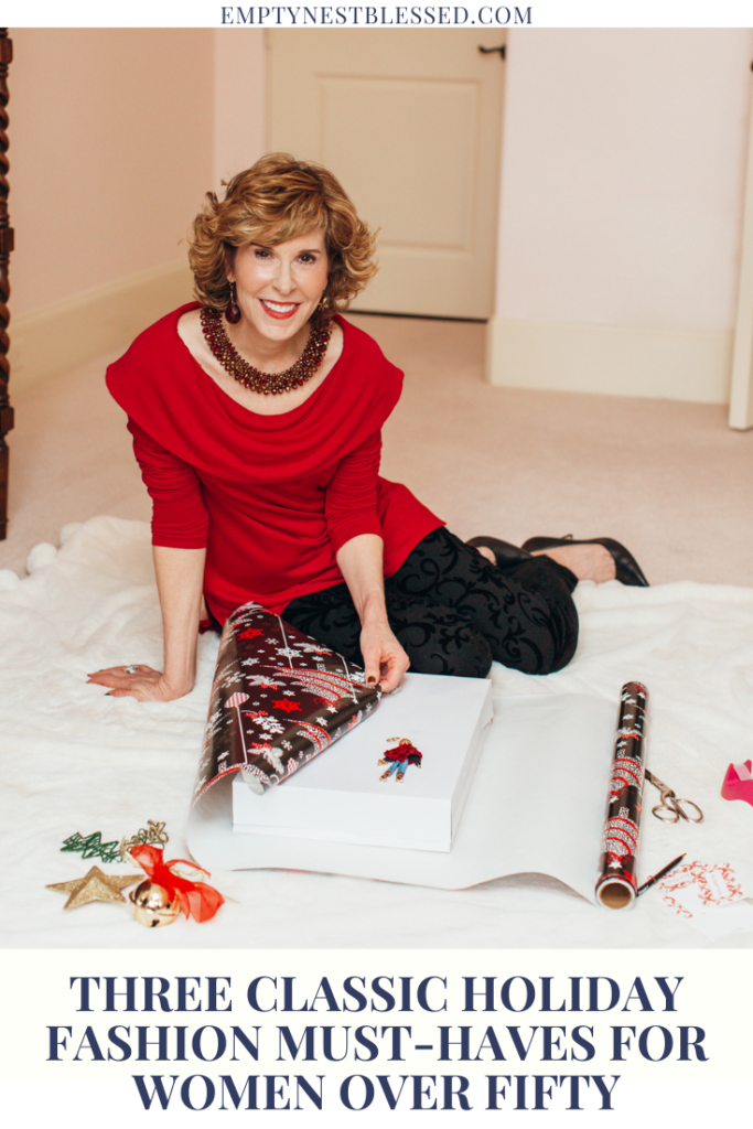 woman sitting wearing red sweater wrapping christmas gift