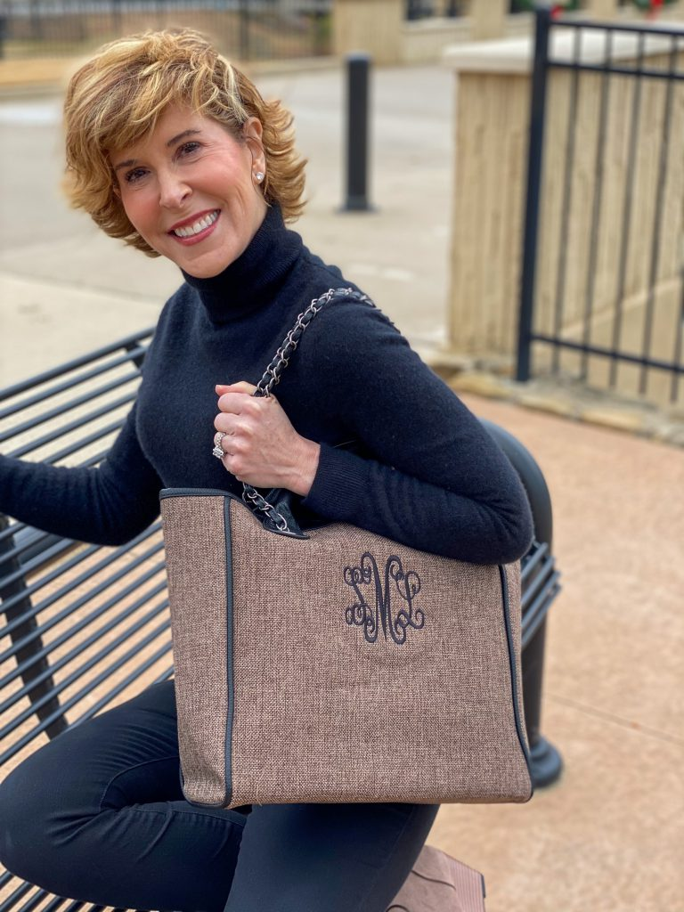 woman dressed in black turtleneck carrying Monogrammed Charlotte Handbag from marley lilly