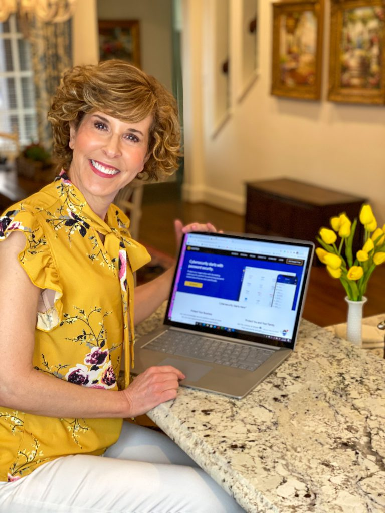 woman in yellow blouse showing her digital