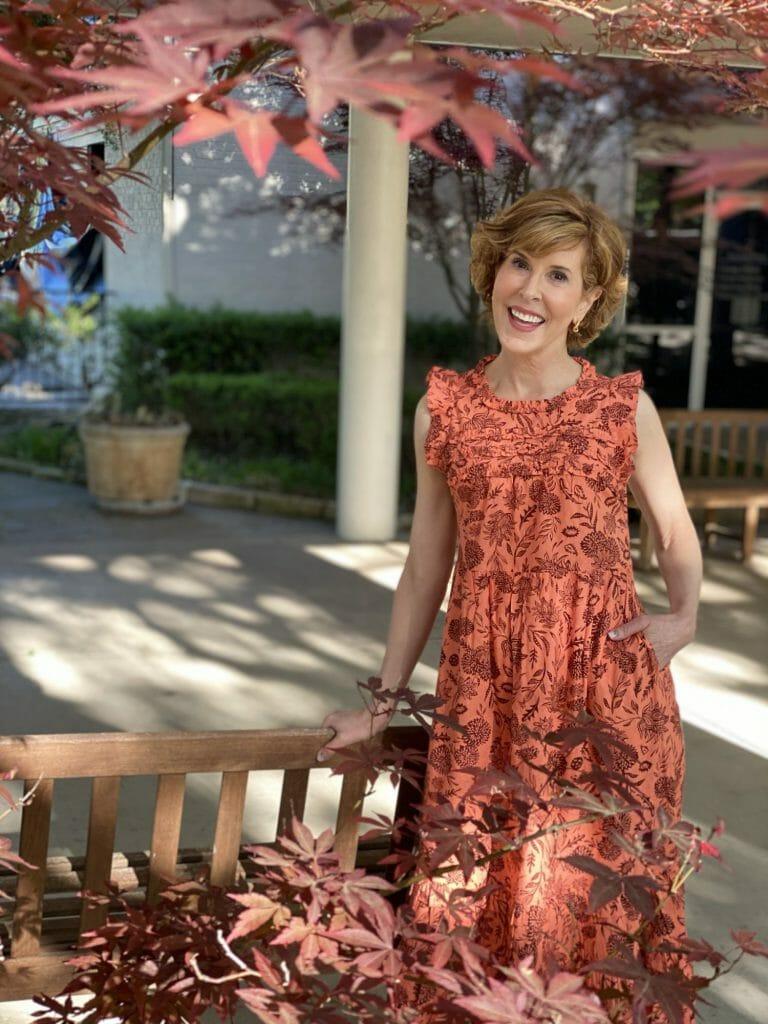 woman standing near trees wearing Floral Print Ruffle Sleeveless Dress - Universal Thread™