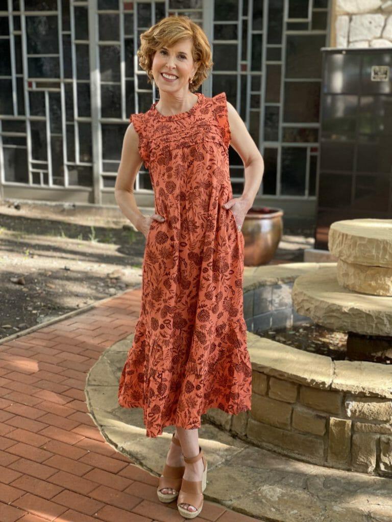woman wearing target Floral Print Ruffle Sleeveless Dress - Universal Thread™