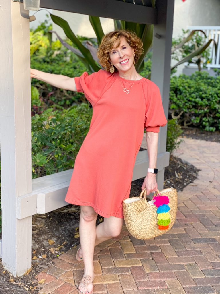 woman wearing Puff Short Sleeve T-Shirt Dress by Universal Thread at Target and carrying cabana life's live bright handbag