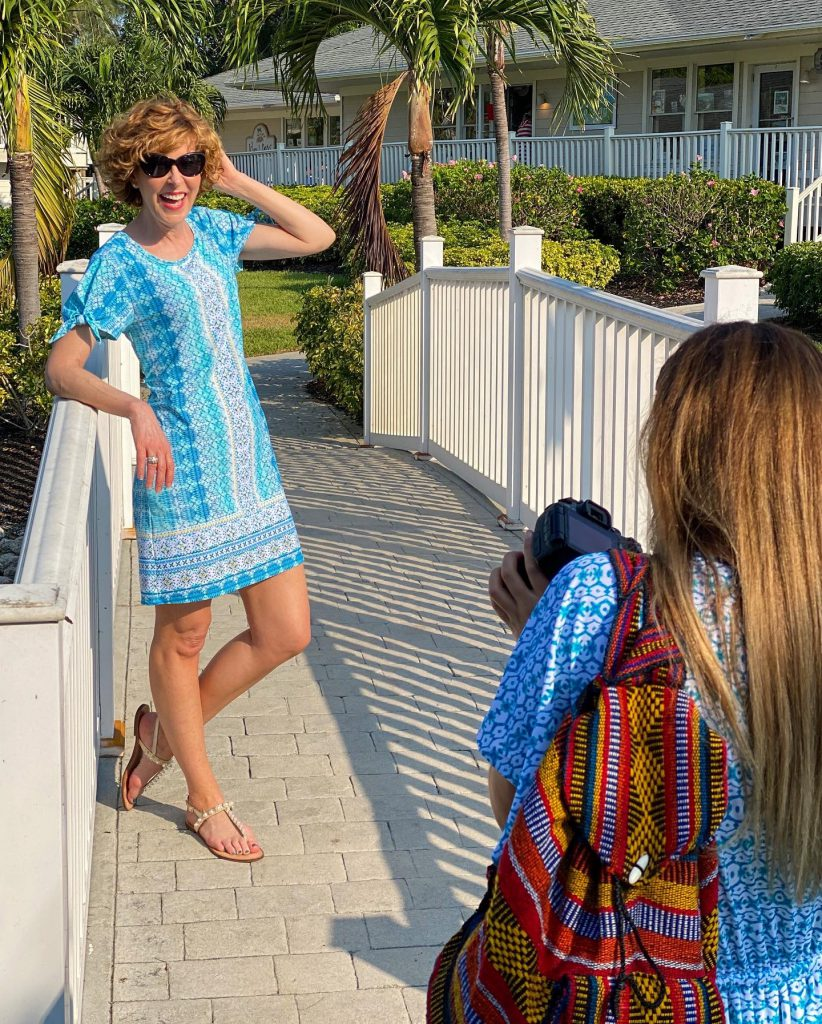 woman over 50 wearing cabana life Coastal Cottage Tie Sleeve Swing Dress standing on a white bridge