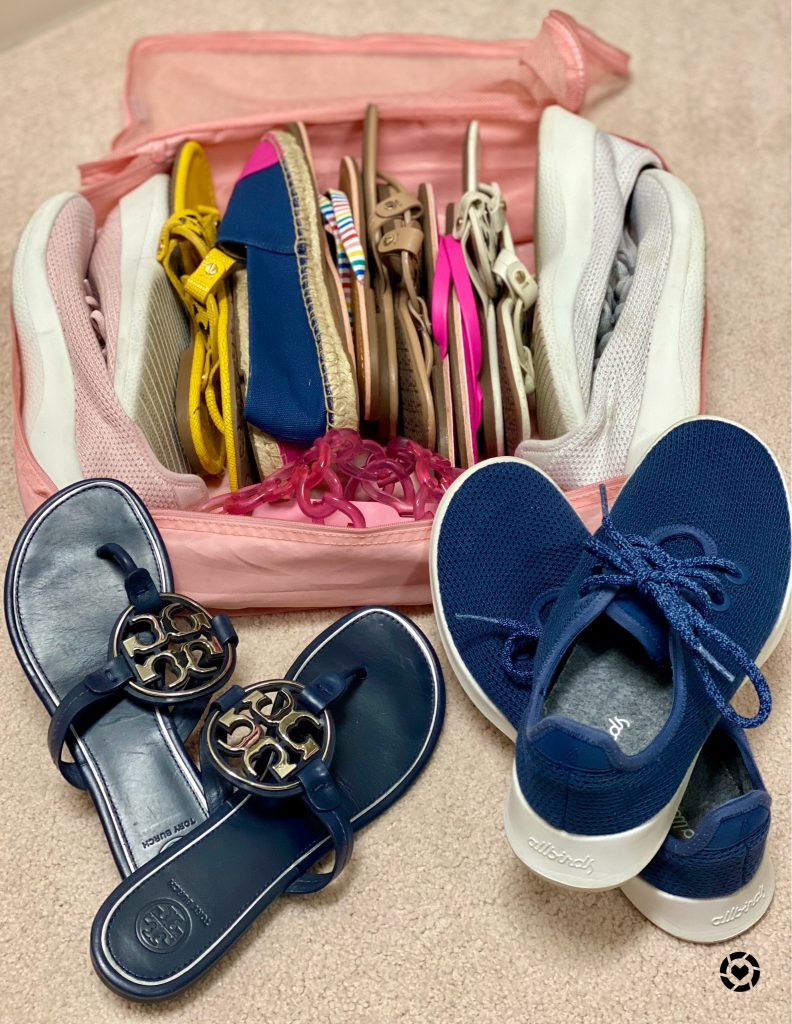 Shoes and flip flops in a pink packing cube