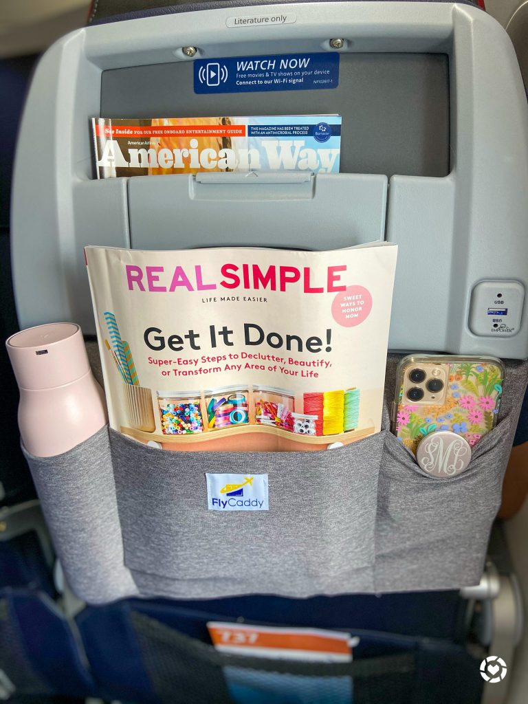 Fly Caddy organizer on an airplane tray table