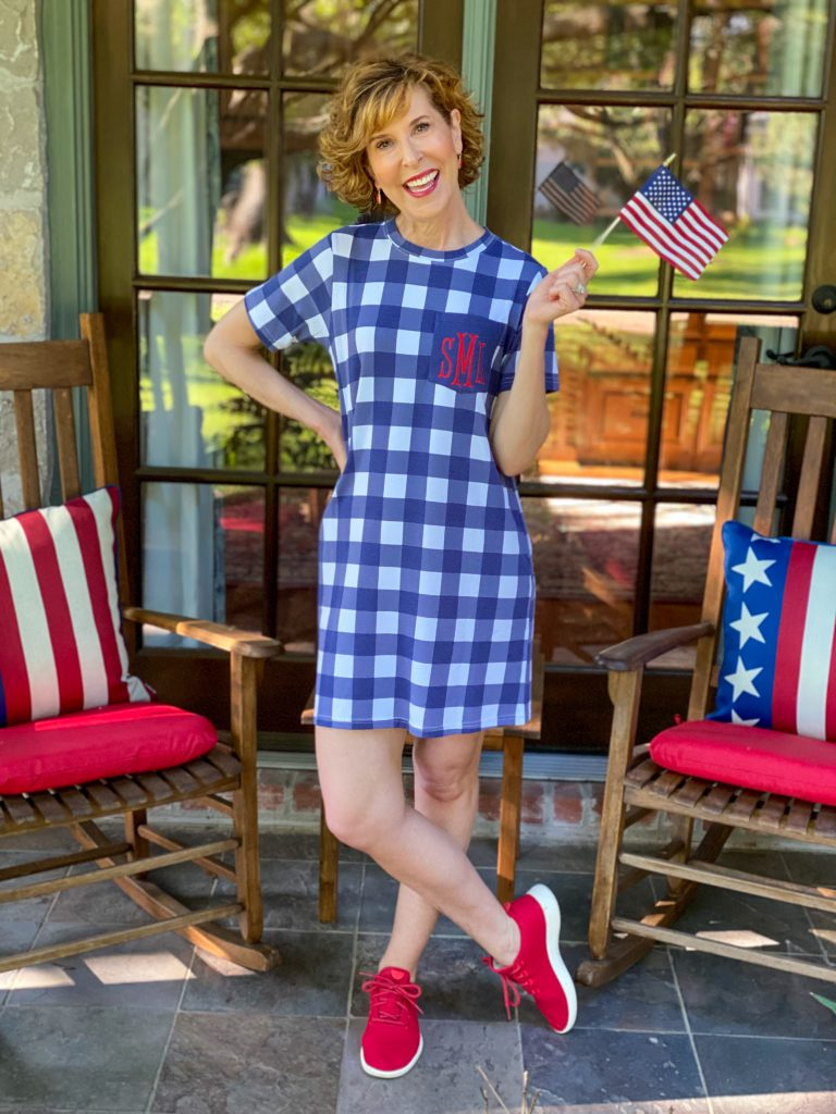 woman wearing marley lilly blue gingham dres and red sneakers on front porch