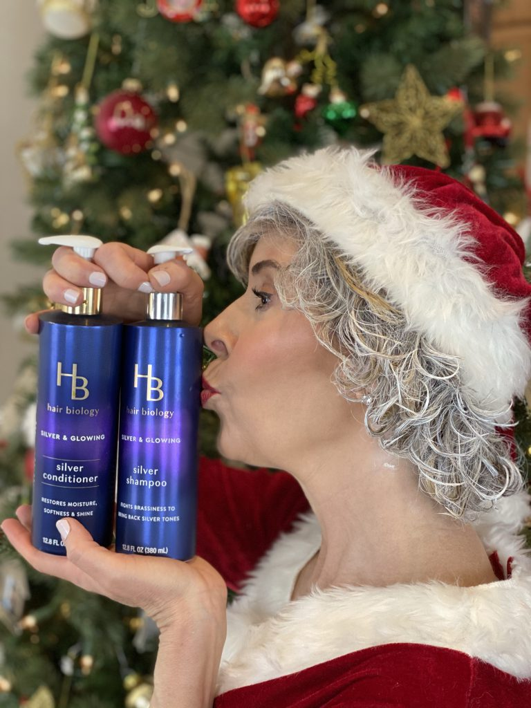 mrs claus kissing hair biology's silver and glowing shampoo and conditioner