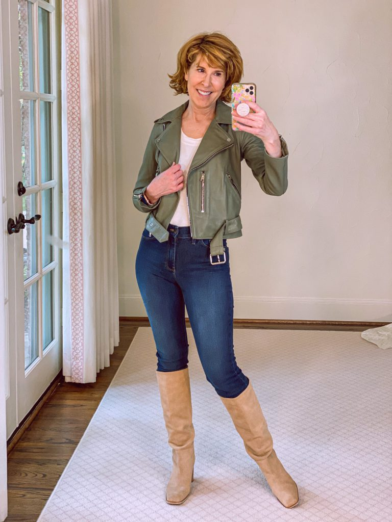 woman wearing sage green leather biker jacket from Nordstrom Anniversary Sale with jeans and Olly Knee High Boot