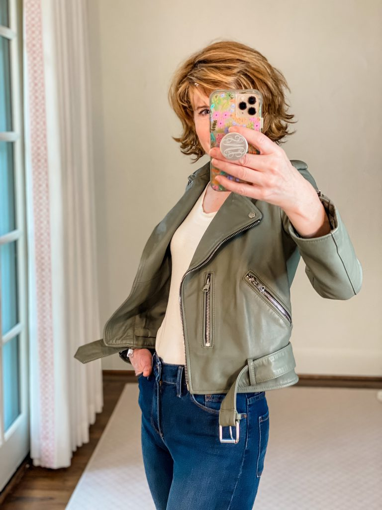 woman wearing sage green leather biker jacket from Nordstrom Anniversary Sale with amazon scoop neck tee