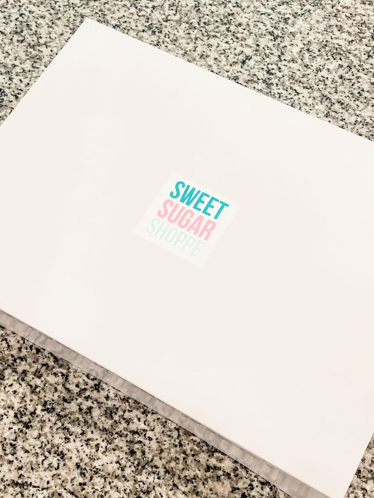 white box with sweet sugar shoppe sticker on top