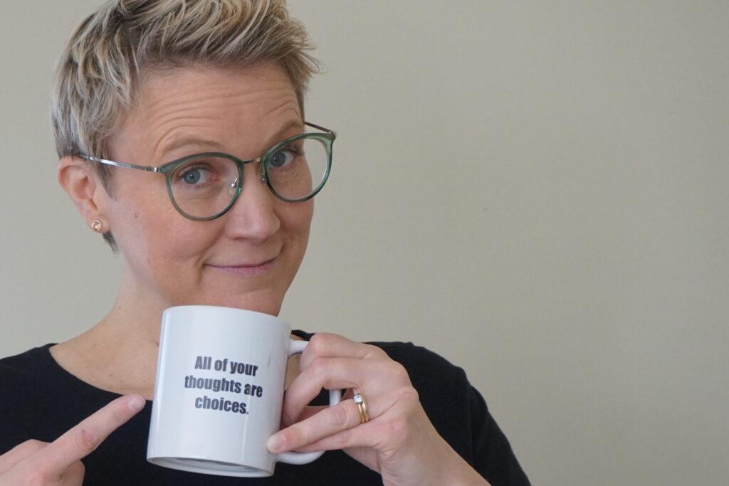 photo of empty nest coach christine holding coffee mug